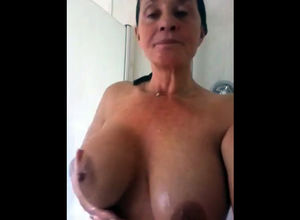 Huge-titted grannie taking a shower...
