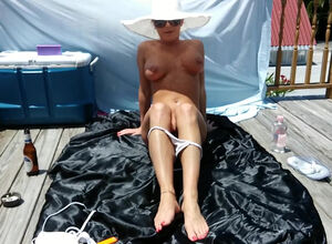 Fat breast MILF sunbathing go-go