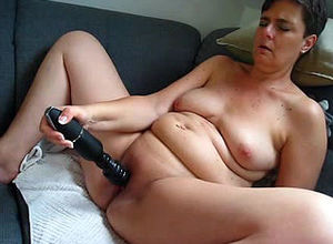 Sex-starved mature thrusts magic wand..
